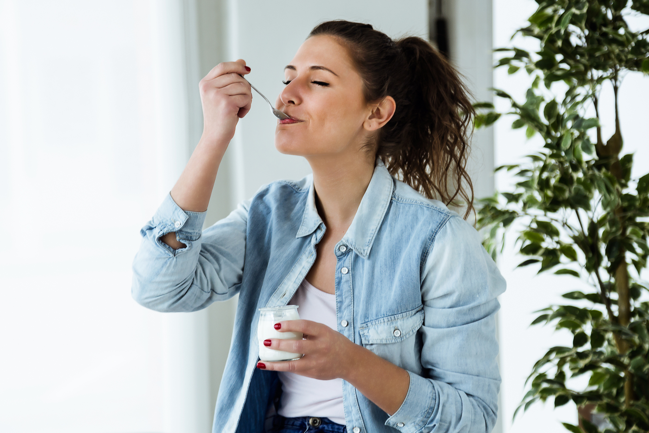 Generic photo of young woman eating yogurt at home (Thinkstock/PA)