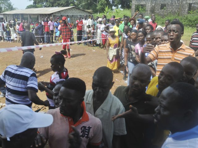 People wait to cast their votes in Monrovia