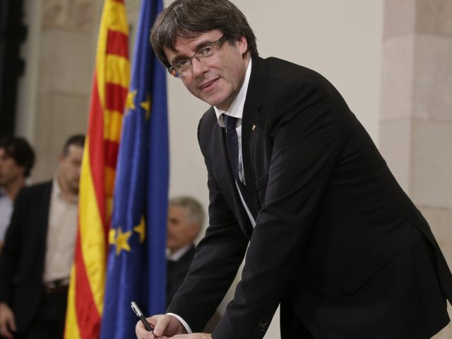 Catalan regional President Carles Puigdemont signs the independence declaration