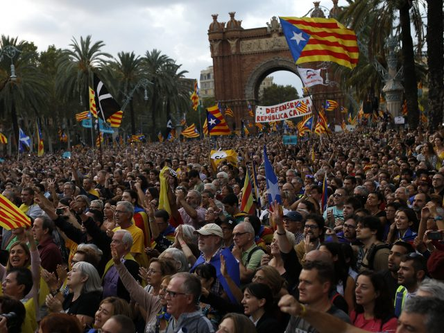 Pro-independence supporters take part in a rally in Barcelona