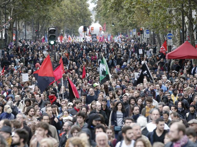 Demonstrators march to protest against President Emmanuel Macron's economic policies in Paris
