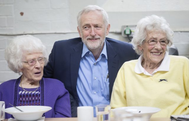 Mr Corbyn helped make a berry crumble at the Kirkgate centre (Danny Lawson/PA)