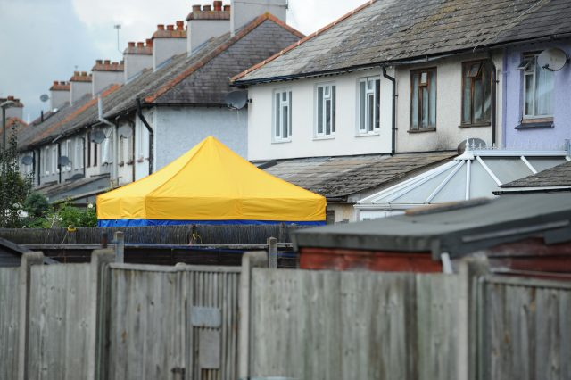 A police tent in the back garden of a house in Sunbury-on-Thames, searched by officers