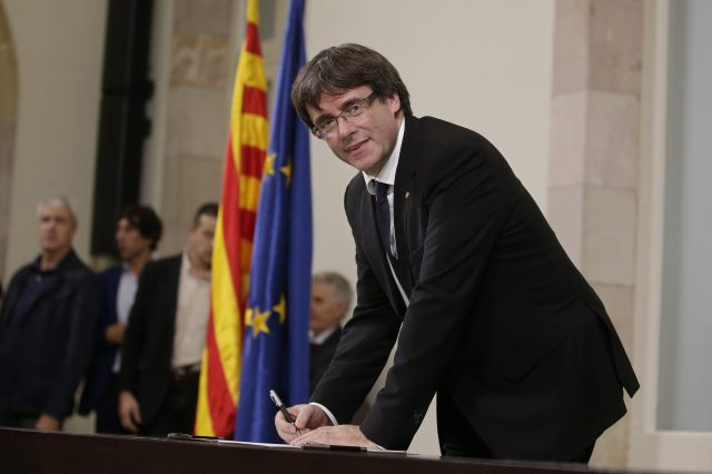 Carles Puigdemont signs an independence declaration document