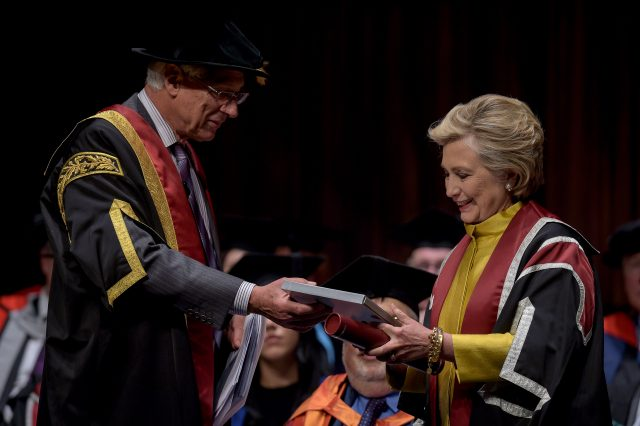 Mrs Clinton was handed a book of her Welsh family history by Pro-Chancellor Sir Roderick Evans (Ben Birchall/PA)