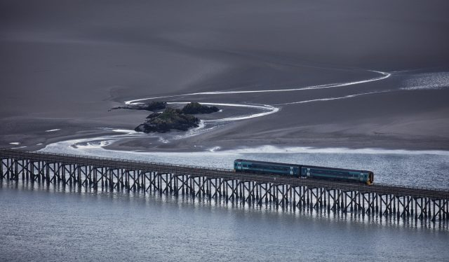 A train crossing the Barmouth Viaduct over the River Mawddach in North Wales