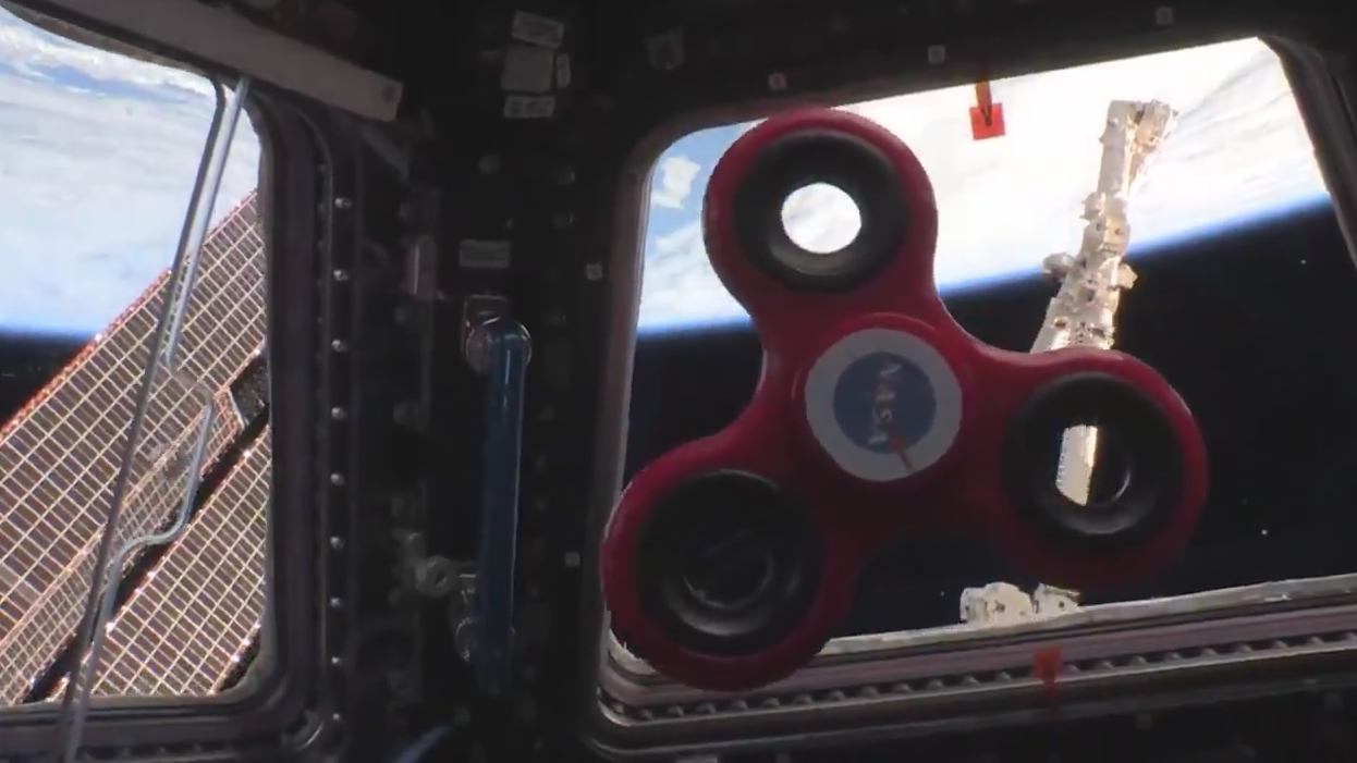 A fidget spinner spinning in the ISS cupola (Randy Bresnik/Nasa)