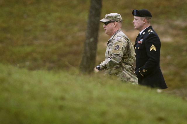 Army Sergeant Bowe Bergdahl, right, arrives for a motions hearing