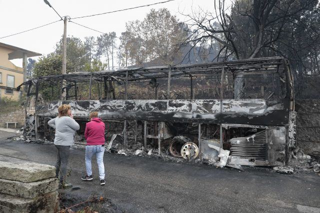 Remains of a burned coach after a wild fire in Pontevedra