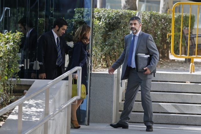 Catalan police chief Josep Lluis Trapero, right, leaves the national court