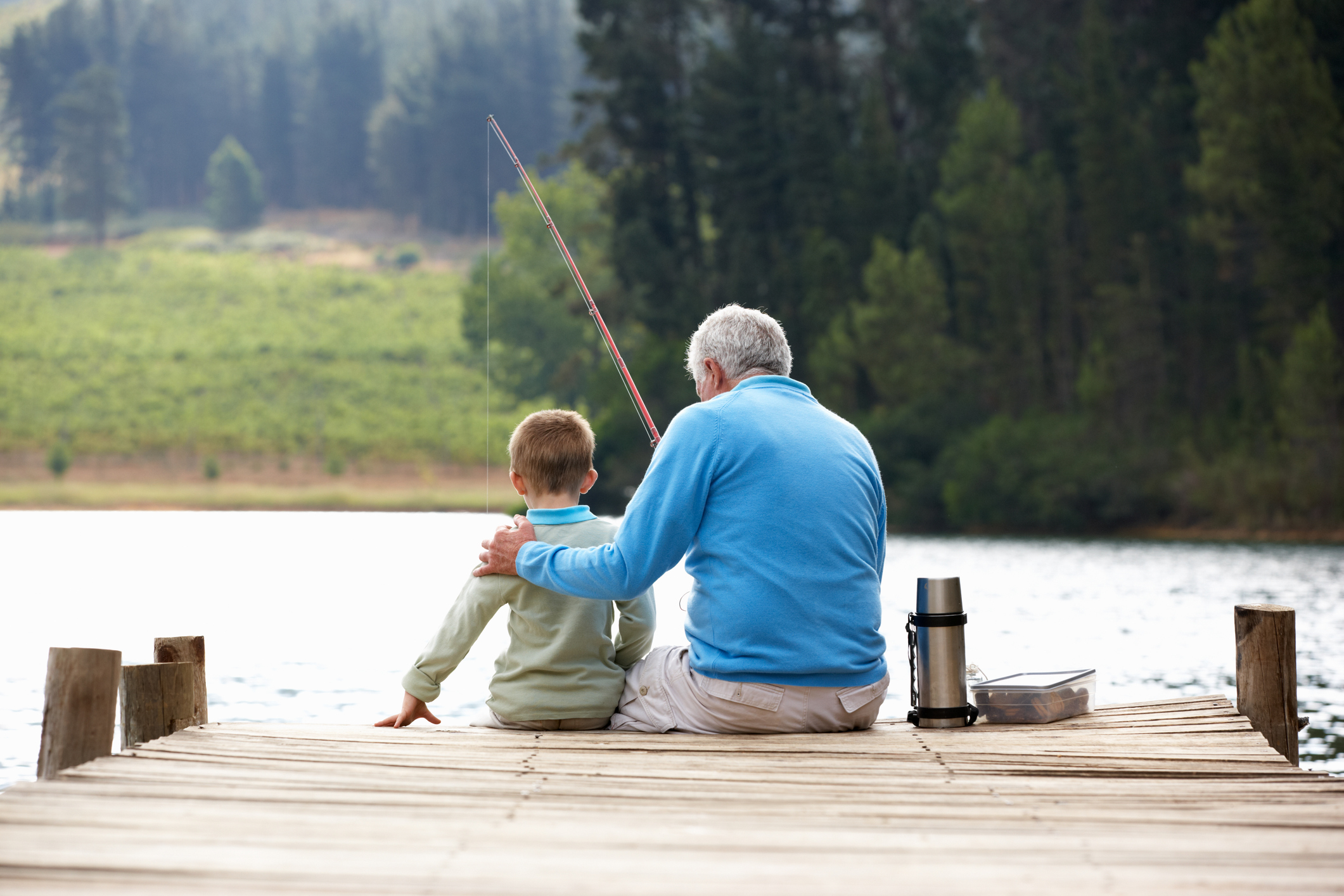 A grandad fishing with his grandson (Thinkstock/PA)