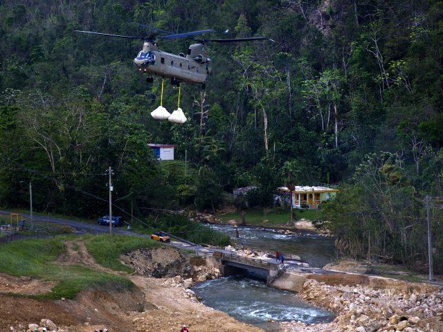 The US Army brings repair materials to the Guajataca Dam in Quebradillas, Puerto Rico