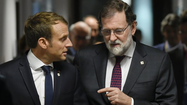 Spanish Prime Minister Mariano Rajoy, right, speaks with French President Emmanuel Macron prior to a meeting on the sidelines of an EU summit in Brussels