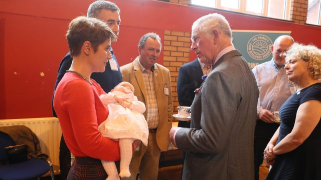 Prince Charles speaks to poultry farmers Nicola Hempton, her husband Thomas and their daughter 11-week-old Lyla during his visit to Northern Ireland