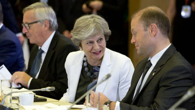 Prime Minister Theresa May, center, speaks with Malta's Prime Minister Joseph Muscat