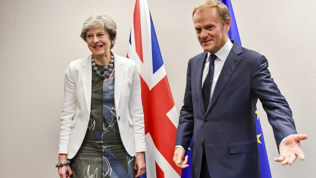 Theresa May is welcomed by European Council President Donald Tusk for a bilateral meeting during an EU summit in Brussels