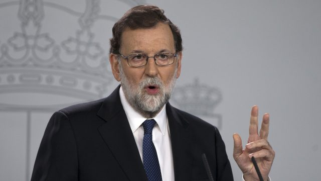 Mariano Rajoy's government is activating a previously untapped constitutional article to take control of Catalonia (Paul White/AP)
