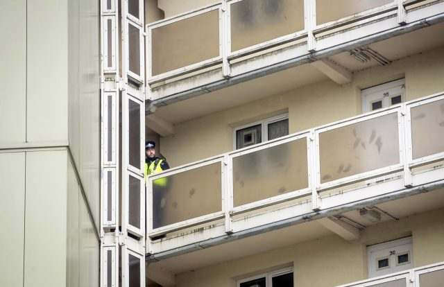 A police officer on a balcony at Newcastle House
