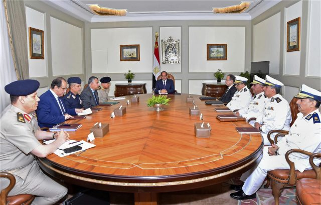 Abdel-Fattah el-Sissi, centre, chairs a meeting attended by the country's top security officials in Cairo