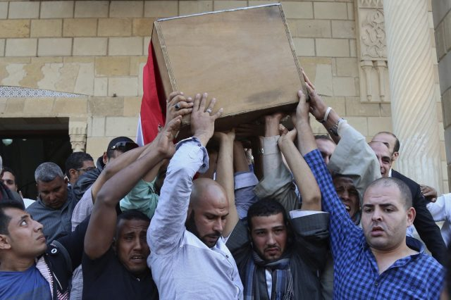 People carry the coffin of police captain Ahmed Fayez, who was killed in a gun battle in al-Wahat al-Bahriya area in Giza province, during his funeral at Al-Hosary mosque in Cairo