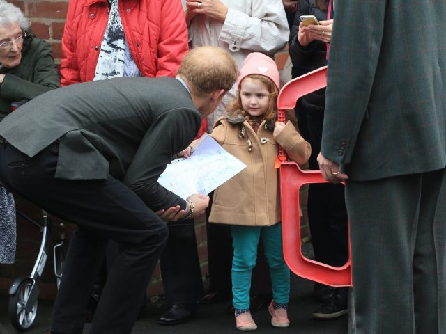 The prince was presented with a drawing by a young fan in St Michael's on Wyre