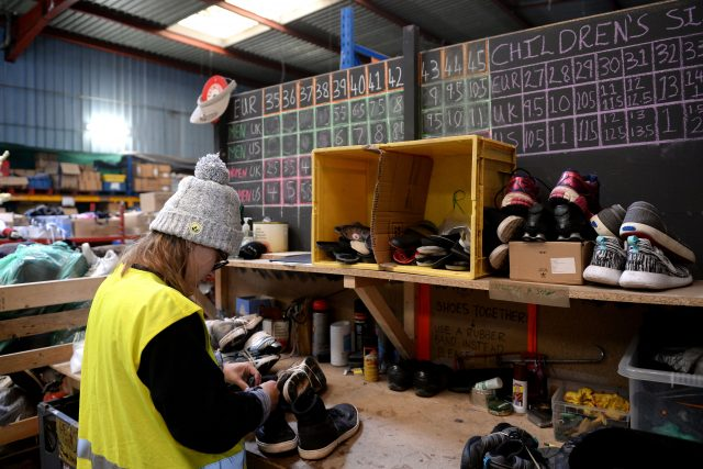 Volunteers sort donations at a warehouse in Calais