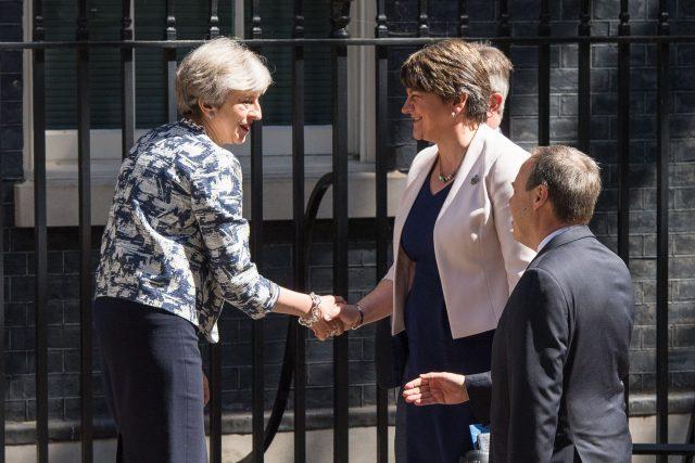 Theresa May greets DUP leader Arlene Foster, DUP deputy leader Nigel Dodds and DUP MP Sir Jeffrey Donaldson