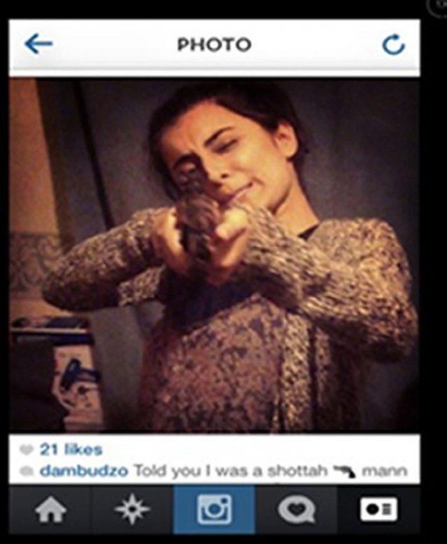 Madihah Taheer with a gun