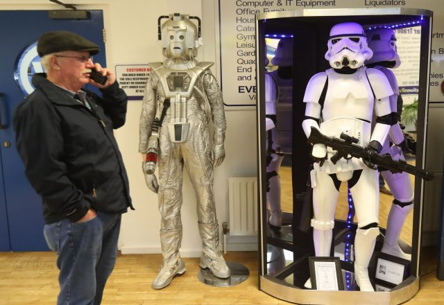 A member of the public view items of movie memorabilia seized from a drugs lord