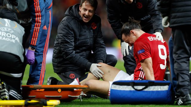 Manchester United's Zlatan Ibrahimovic receives treatment for an injury during the UEFA Europa League