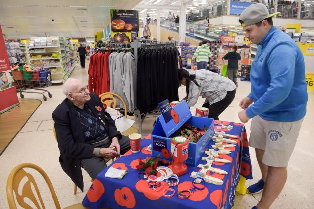 Mr Jones at his selling station inside Tesco supermarket, Newport (Ben Birchall/PA)