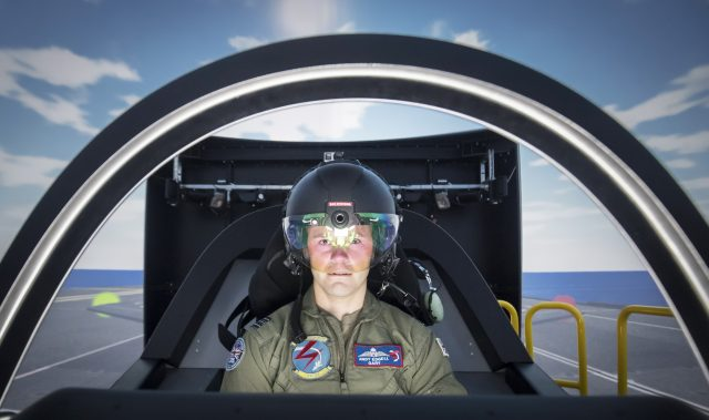 RAF Squadron Leader Andy Edgell, the UK's lead test pilot, uses a specialist fighter jet simulator at BAE Systems in Warton, Lancashire