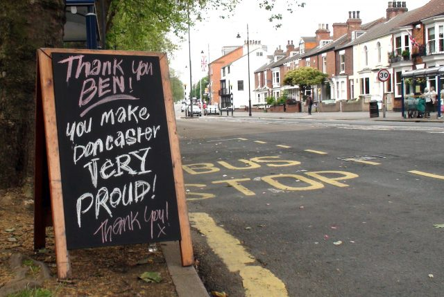 A sandwich board in Doncaster with a tribute message to Lance Bombardier Ben Parkinson, 27, the most seriously wounded soldier to survive the war in Afghanistan, who carried the Olympic Flame through his home town of Doncaster