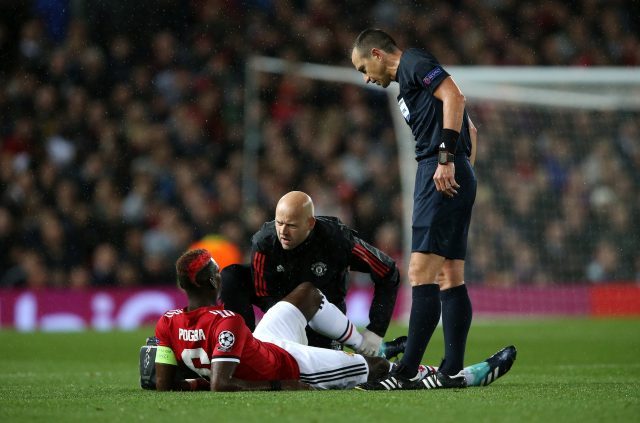 Manchester United's Paul Pogba on the ground after picking up an injury