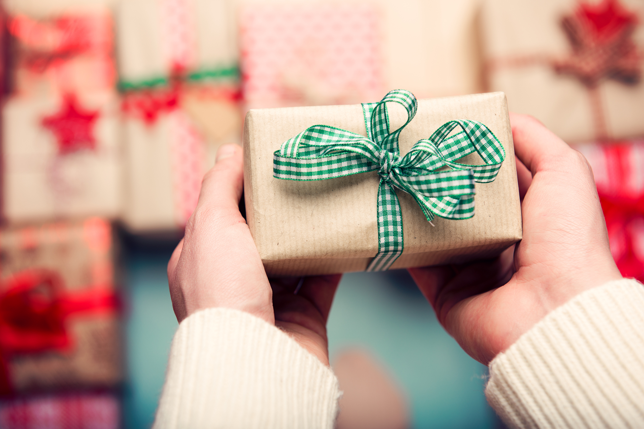 A woman holding a gift