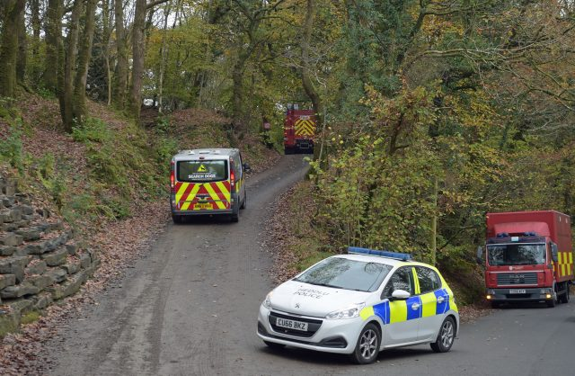 Police vehicles and fire engines drives towards the scene in Llangammarch Wells, Powys