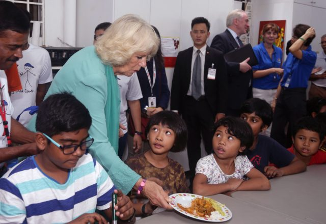 The Duchess of Cornwall serving food for residents at The Lighthouse Children's Welfare Centre, during a visit to The Lost Food Project - the first professional food bank in Malaysia, reclaiming high quality surplus food from supermarkets and manufacturers, sorting and distributing them to a wide variety of charities on a non-discriminatory basis - in Kuala Lumpur, Malaysia. The Lighthouse Children's Welfare Home houses 60 disadvantaged children, aged one to 18 years old.