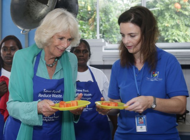 The Duchess of Cornwall prepares food for residents of The Lighthouse Children's Welfare Centre.