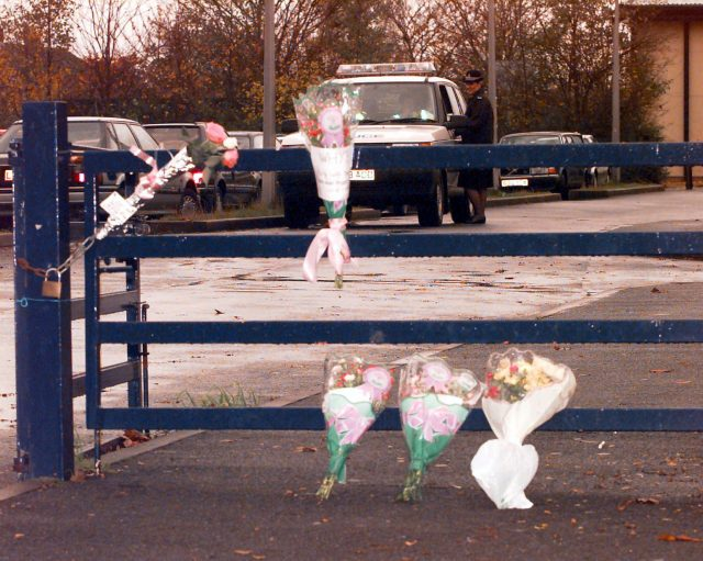 Flowers tied to the gates of a school in Exeter in memory of Kate Bushell