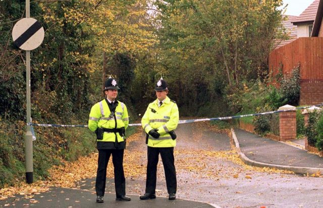 Police guard the scene in Exeter where Kate Bushell was found murdered