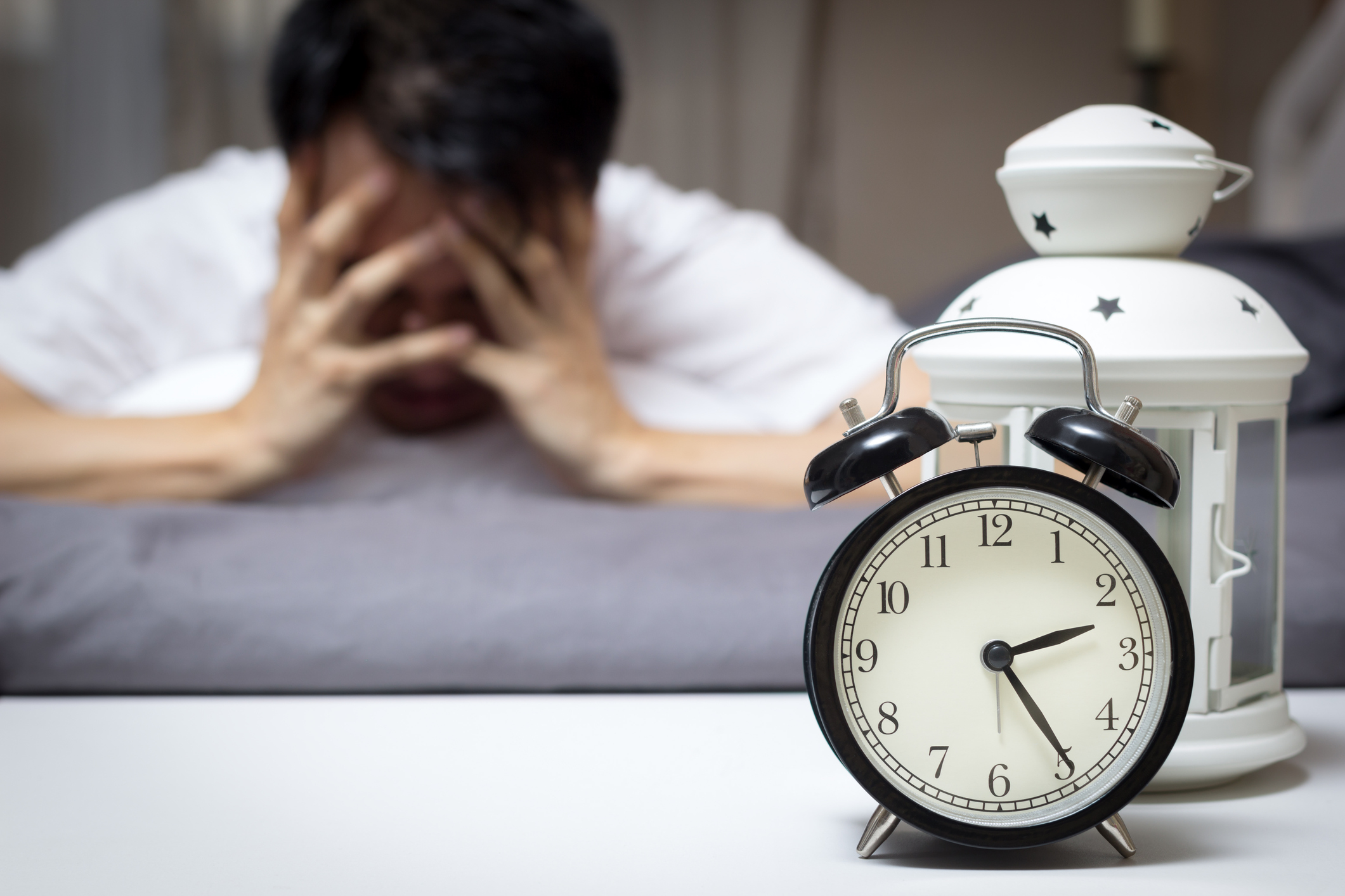 Asian man in bed suffering insomnia (Thinkstock/PA)