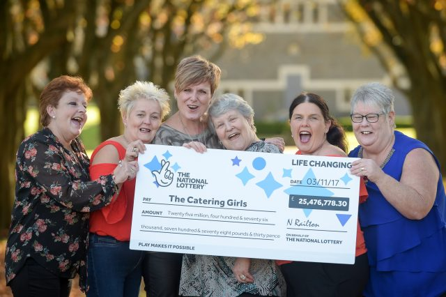 EuroMillions winners Julie Saunders, Doreen Thompson, Julie Amphlett, Jean Cairns, Louise Ward and Sian Jones celebrate during a photocall at Hensol Castle