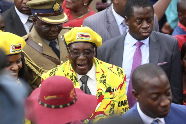 Zimbabwe President Robert Mugabe smiles as he arrives for a a solidarity rally in Harare