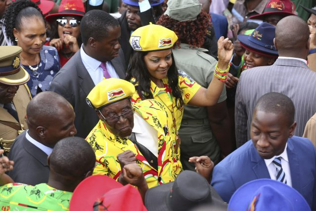Zimbabwe President Robert Mugabe and his wife Grace greet supporters at a solidarity rally in Harare