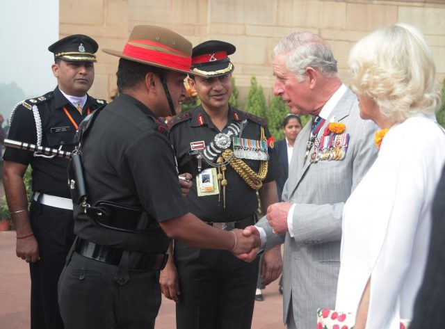 Charles and Camilla meet Gurkha soldiers during a visit to India Gate for a wreath laying ceremony, in New Delhi