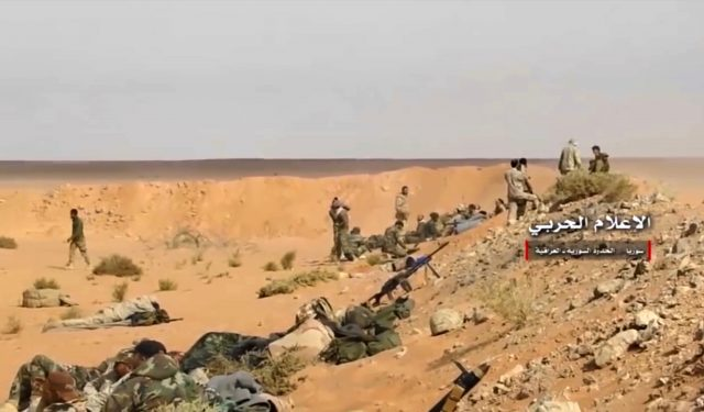 Pro-government troops take up positions on the Iraq-Syria border