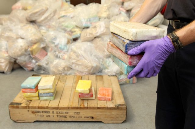 An HM Customs and Excise officer holds some of the drugs recovered during the UK's largest ever cocaine seizure.  (Dominic Lipinski/PA)