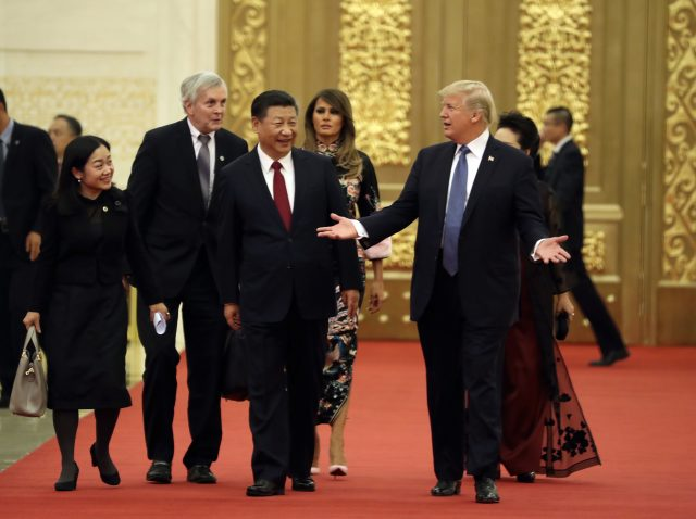 Mr Trump arrives for a state dinner with Chinese President Xi Jinping (Andrew Harnik/AP)