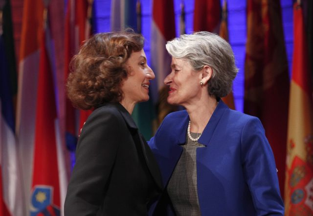 Unesco's newly elected director-general Audrey Azoulay, left, greets outgoing director-general Irina Bokova during the 39th session of the General Conference at the Unesco headquarters in Paris