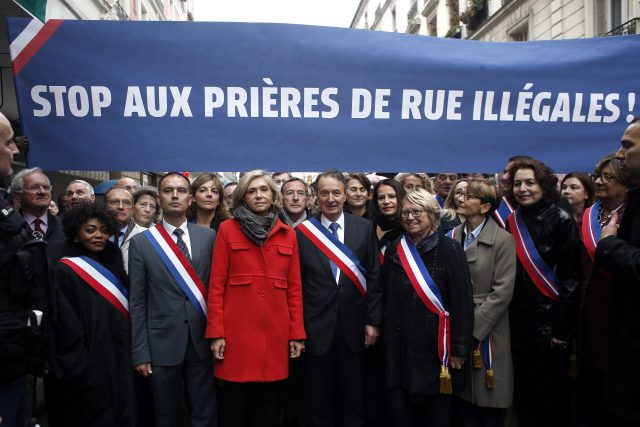 Clichy la Garenne's mayor Remi Muzueau, centre right, and President of the Regional Council of the Ile-de-France region Valerie Pecresse, centre left, demonstrate against Muslim street prayers
